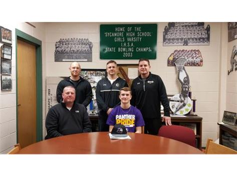 Zach Carlsen signs with Ellsworth Community College to play baseball.