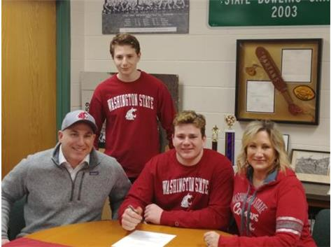 Jake Siegal signs with Washington State to play Football.