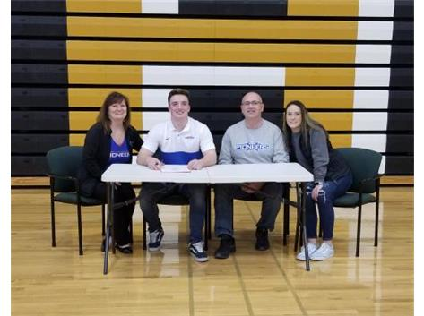 Kyle Antos signs with Wisconsin Platville to play football.