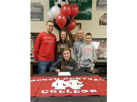 Ellie Lochbaum signes with North Central College to play soccer.