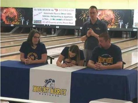 Megan Kolberg signed with Mount Mercy to bowl.