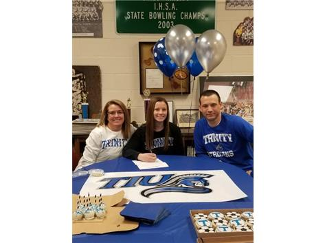 Payton Siragusa signes with Trinity International to play soccer.