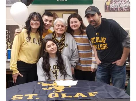 Addison Cortinas signes with St. Olaf College to play soccer.