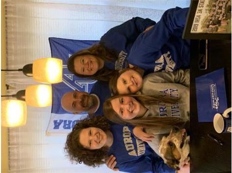 Erin Simmons signs with Aurora University to play softball.