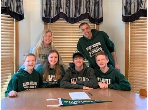 Isaac Plagakis signs with Illinois Wesleyan to play soccer.