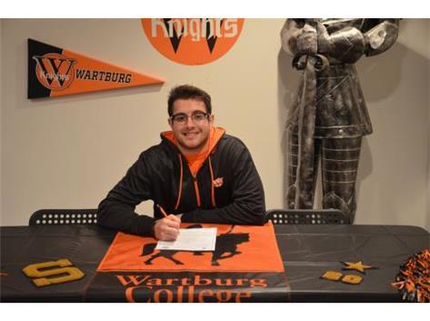 Zak Kozumplik signs with Wartburg College to wrestle.