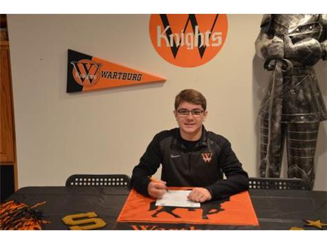 Alex Crawford signs with Wartburg College to wrestle.