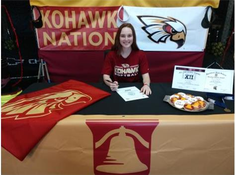 Emmalee Torson signs with Coe College to play softball.