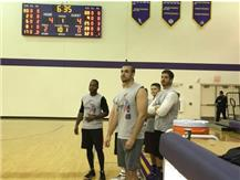 Police Team Watches Their Teammates On The Court