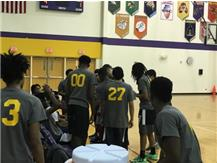 TFN Student Teams Listen To Coach Eric Bryce Before Going Back On The Court