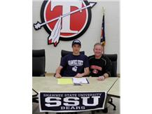 Brandon Pursifull signs with Shawnee State. Pictured with Coach Holbrook.
