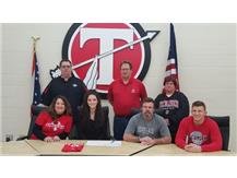 Micaela Pierson signs with Sinclair to continue her education and softball career.