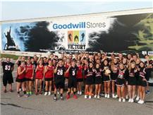 "Members of various teams help support Goodwill and Channel 7's ""Drive to Victory"" contest vs. Fairborn."