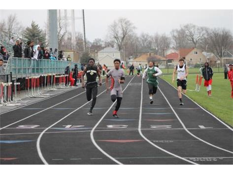TJ Ell finishes the 400 meter relay for the JV team and takes first.