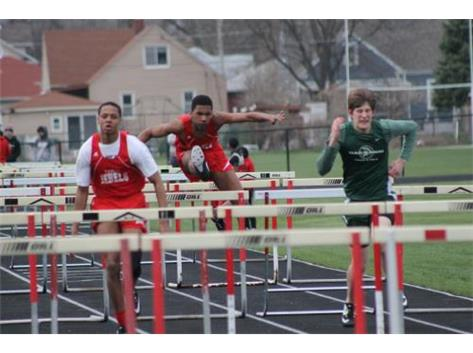 Jayden Webster and Dion Wilson running the High Hurdles