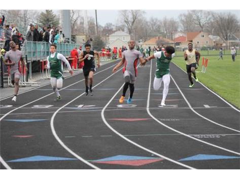 Lance Hale takes 1st in the Varsity 100 meter dash.