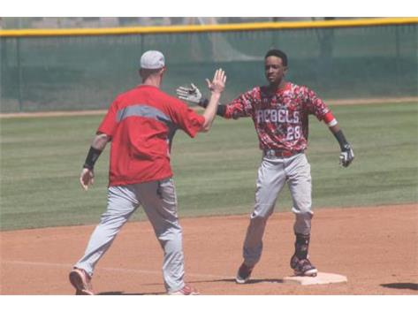 Coach Tiffy congratulates SR Jalil Banks after hitting a triple.