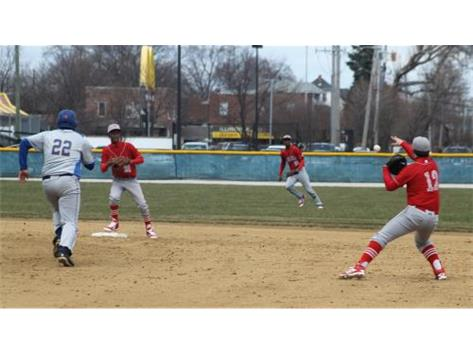2B Reis Padjen (SR) feeds SS Jalil Banks (SR) to begin a Rebel double play in their season opening win over Joliet Central.