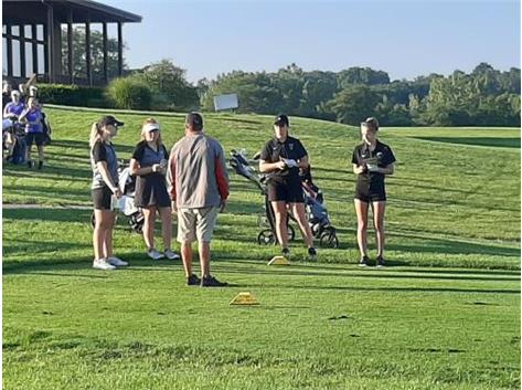 Coach Johnson laying the ground rules out at Woodland for the girls golf match between Triad and Mechanicsburg
