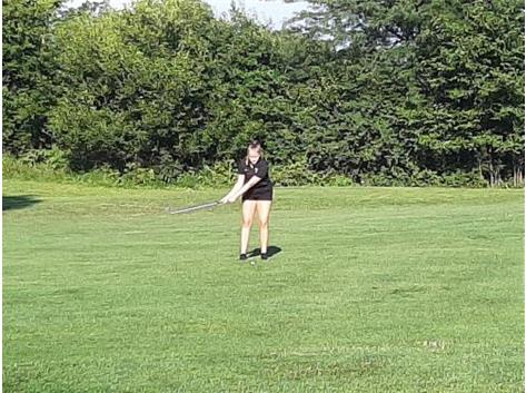 Ali hitting her approach shot from the fairway on hole #2 at Woodland