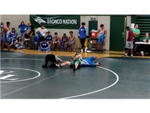 Tyler Schuld pinning his opponent.