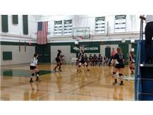 Junior Emily Giannotta setting the ball.