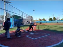 Home Run Swing - Mimi Rieger - (see the yellow ball just above one of the light poles)