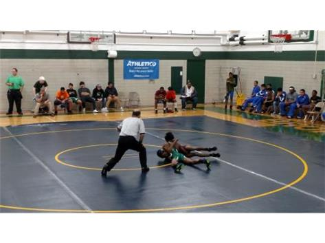 Darryl Norwood pinning his opponent