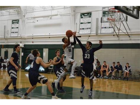 Senior Michael Fowler attacking the basket.