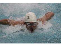 Cam Johnson swims the butterfly leg of the medley relay.