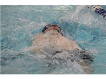 Ben swims the 100 backstroke event.