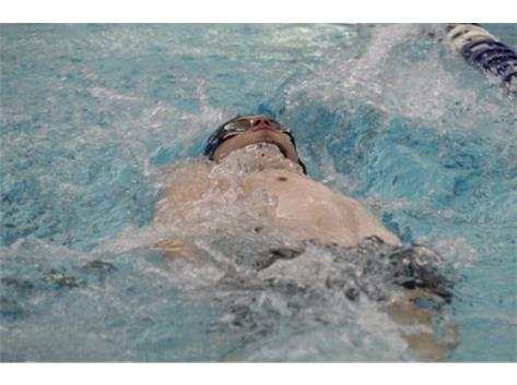 Ben swims the 100 backstroke event.