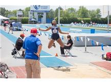 Senior Kayla Battle competing in the Long Jump at the IHSA Girls State Track Meet.