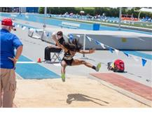 """Senior Rajiah Andrews competing in the Long Jump at the IHSA Girls State Track Meet. Rajiah finished with an 18'2.5"""" placing her 8th in the state."""