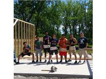 The boys wrestling volunteers in the community.  What a way to give back!