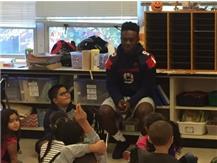 Football Players Volunteering at Nicholson Elementary
