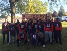 Football Players Volunteering at Nicholson Elementary