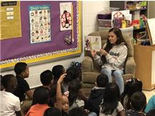 Cheerleaders Volunteer to Read to Students at Smith