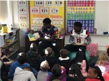 Blackhawk Football Players Volunteer to Read at Schneider