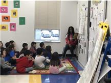 Girls Track volunteers to read at Hill Elementary