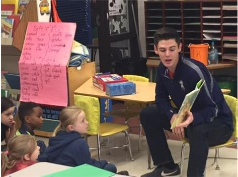 Boys Volleyball Reading to Schneider Students
