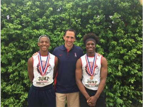 Triple Jumpers DaVion Cross (2nd) and Chris Walker (3rd) with Coach Hilby at the IHSA State Meet