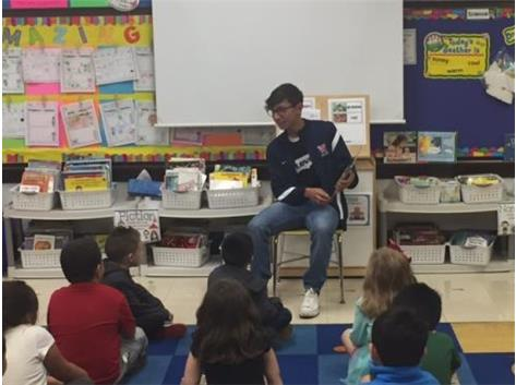 Soccer Players Read at Hill Elementary