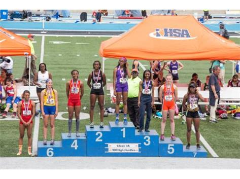 Rajiah Andrews on the stand after taking 3rd place in the 100m Hurdles at the IHSA State Track Meet.