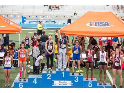 Cinnamon Miles on the stand after winning the 400m Dash at the IHSA State Track Meet.