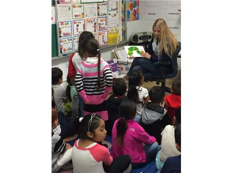 Blackhawk Poms Reading to Students at Smith Elementary