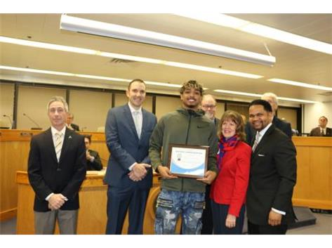 Three-sport athlete Camron Donatlan honored by Mayor Irvin and the City Council for his High Jump State Championship.
