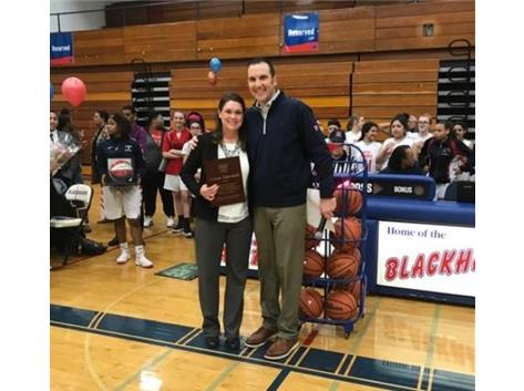 Head Girls Basketball Coach Connie Siljendahl honored prior to her last home game.