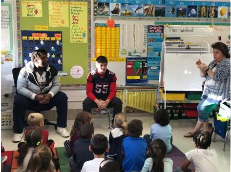 Blackhawk Football Players Volunteer to Read at Schneider