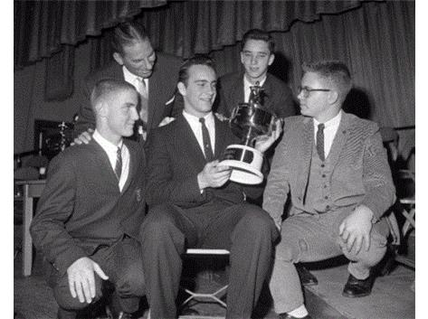 Dennis Rasmusson, Coach Joe Kupcinet, Art Seplak and Jim Ohlson congratulate Jim Grabowski, a student of Taft High School for receiving the Sun Times Player of the Year Trophy. Jan 11, 1962